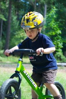 This boy loves his bike.